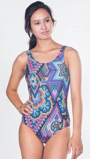 closeup front view of model wearing purple latin beads themed one piece swimsuit / leotard