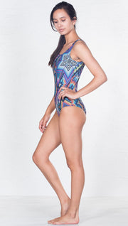 left view of model wearing purple latin beads themed one piece swimsuit / leotard