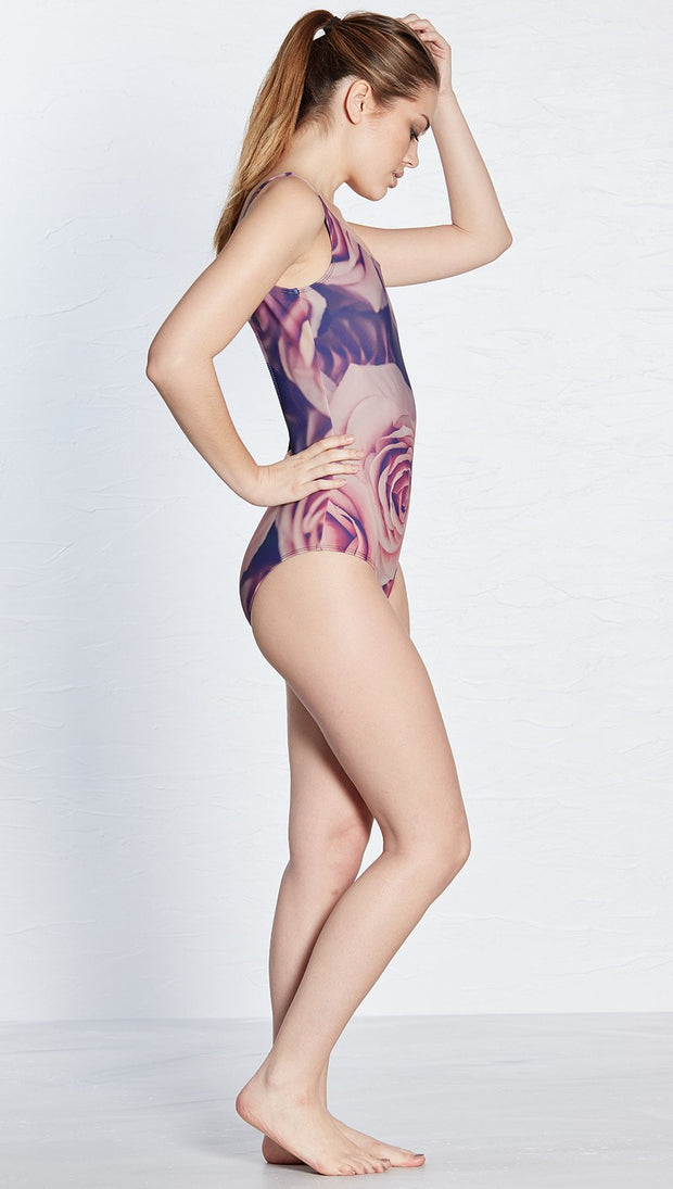 right view of model wearing floral rose themed one piece swimsuit / leotard