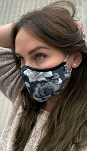 girl wearing face mask with black and white roses artwork