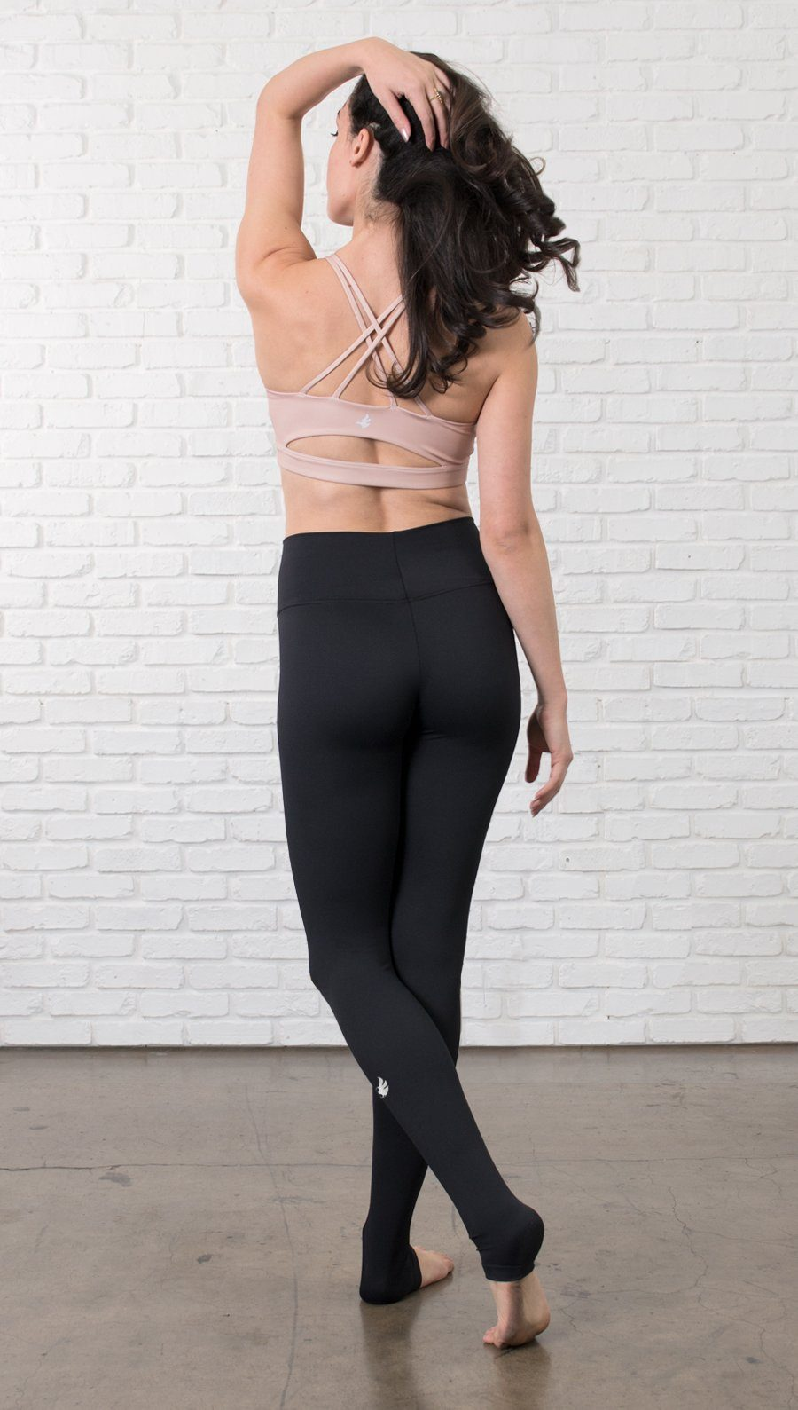 Closeup left view of model wearing black full-length leggings