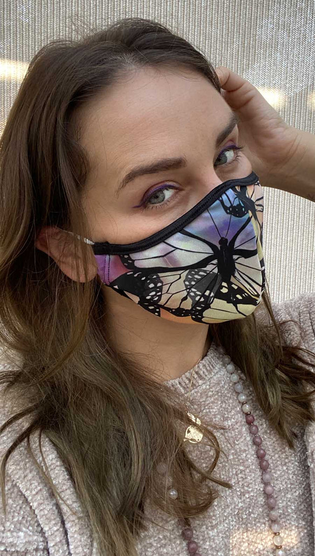 Right side view of model wearing a colorful butterfly themed mask