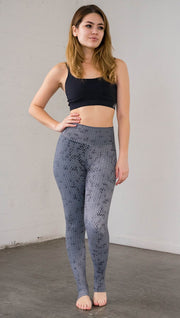 Front view of model wearing chainmaille inspired full length leggings