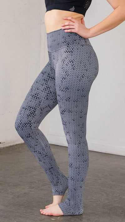 Left side view of model wearing chainmaille inspired full length leggings