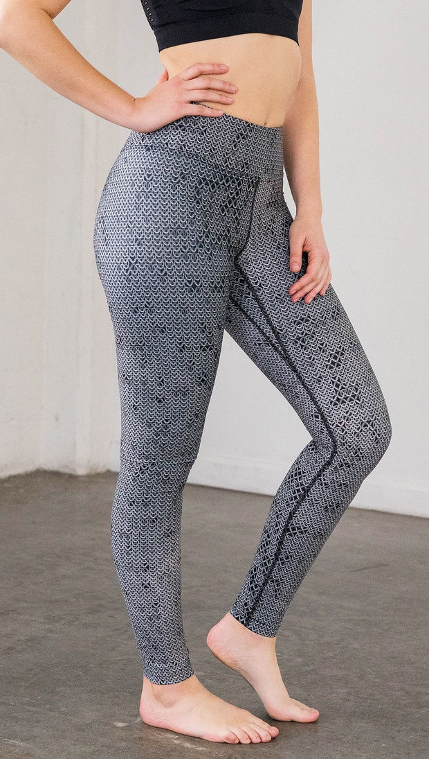 Right side view of model wearing chainmaille inspired full length leggings