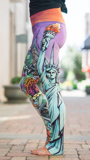 closeup left side view of model wearing full length printed leggings with various cities design