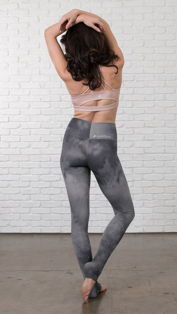 back view of model wearing grey cloud watercolor printed full length leggings