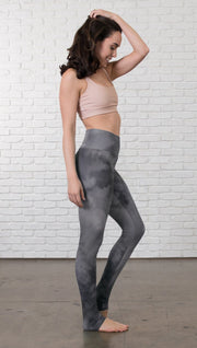 right side view of model wearing grey cloud watercolor printed full length leggings