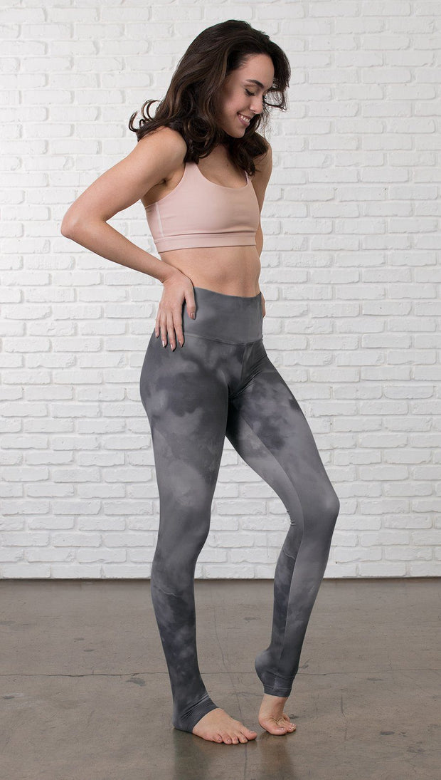 right side side view of model wearing grey cloud watercolor printed full length leggings