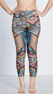 closeup front view of model wearing beaded themed printed capri leggings with eagle motif