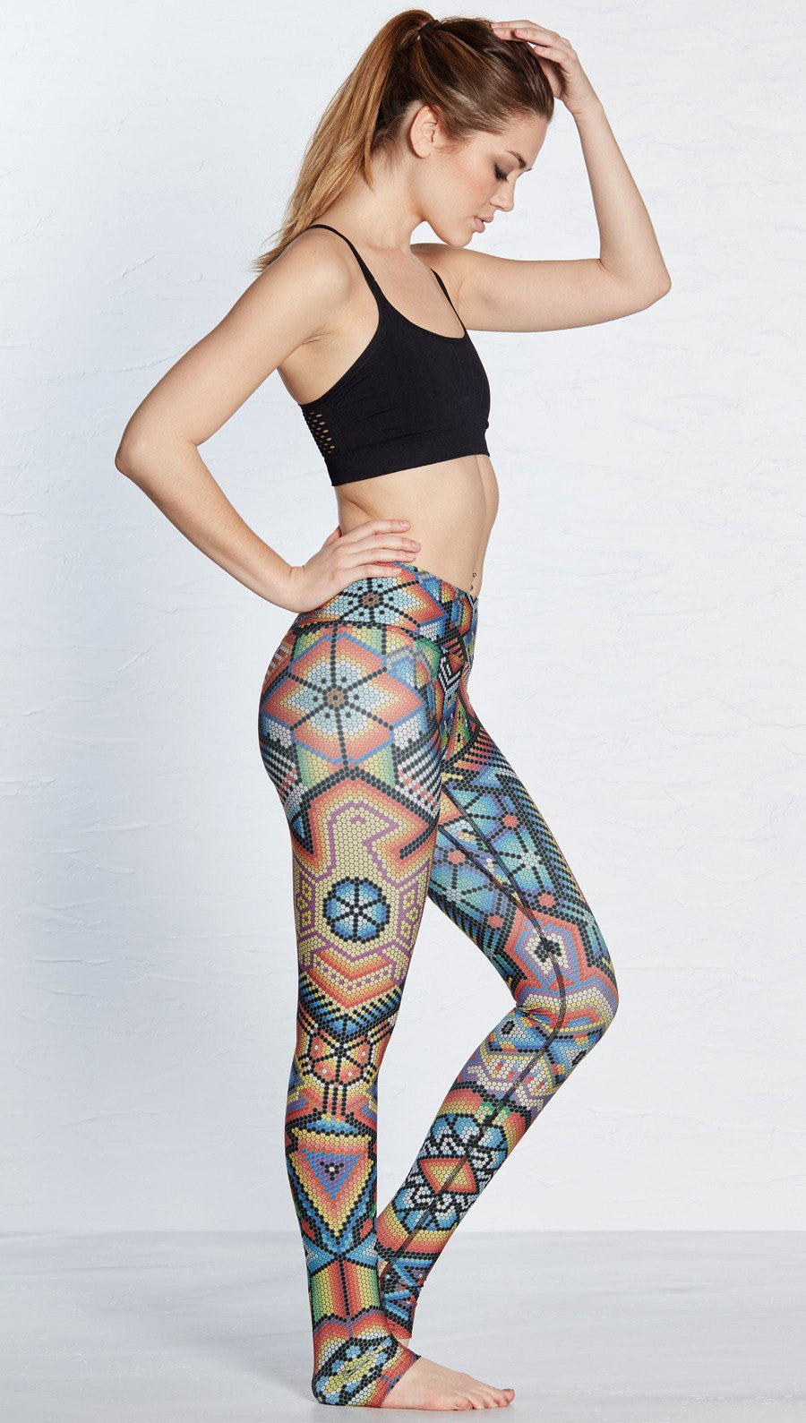 side view of beaded themed printed full length leggings with eagle motif