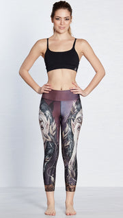 front view of model wearing capri leggings with printed elf design