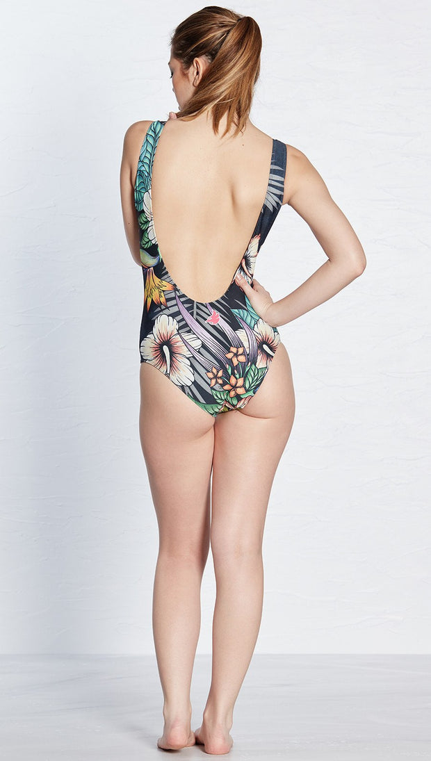 back view of model wearing black floral themed one piece swimsuit / leotard