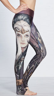 closeup right side view of model wearing full length leggings with printed elf design