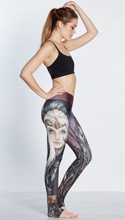 right side view of model wearing full length leggings with printed elf design