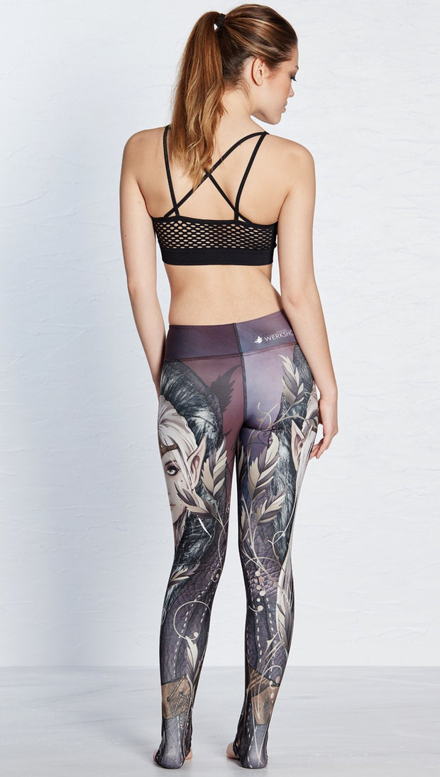back view of model wearing full length leggings with printed elf design