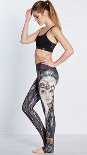 left side view of model wearing full length leggings with printed elf design