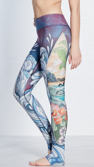 close up side view of island surfboard and waves themed printed full length leggings