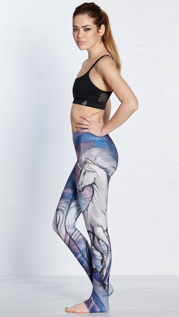 left side view of model wearing unicorn design printed full length leggings