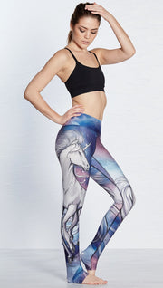 right side view of model wearing unicorn design printed full length leggings