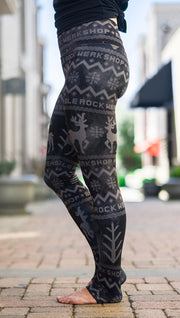 closeup left side view of model wearing holiday themed full length leggings with reindeer and pine tree faux knit design