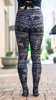 closeup back view of model wearing holiday themed full length leggings with reindeer and pine tree faux knit design