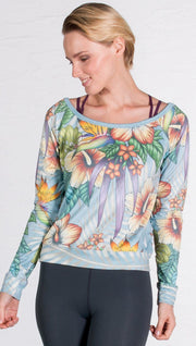 closeup front view of pullover sweatshirt design with tropical floral design and blue background