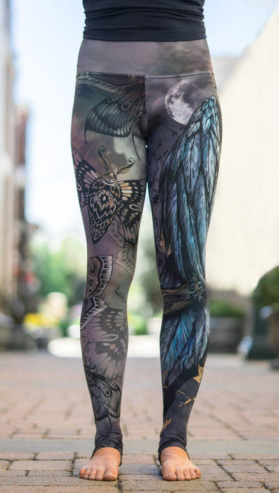 close up front view of model wearing mashup gothic themed printed full length leggings