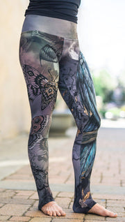 close up front side view of model wearing mashup gothic themed printed full length leggings
