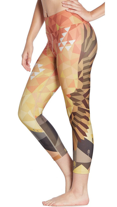 close up side view of southwest themed printed hawk capri leggings