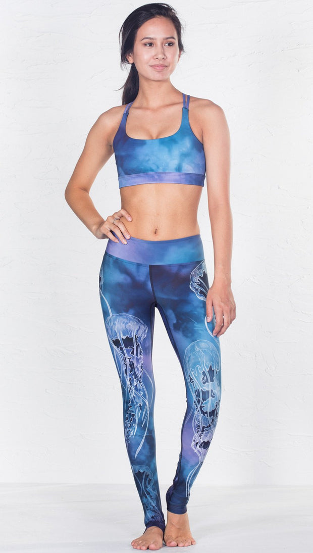 front view of model wearing blue water color inspired printed sports bra