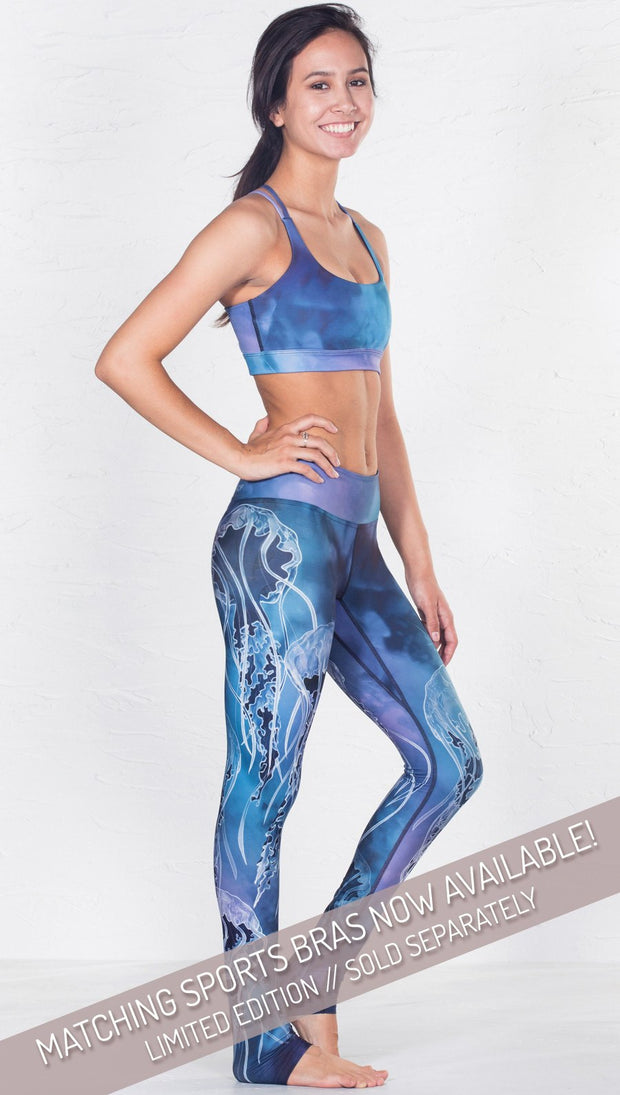 right side view of model wearing jellyfish themed printed full length leggings