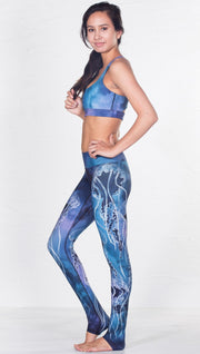 left side view of model wearing blue water color inspired printed sports bra