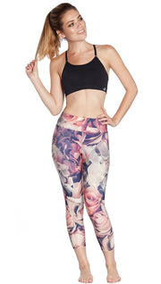 front view of model wearing pink floral printed capri leggings