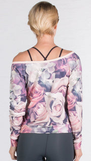 back view of model wearing romantic floral roses printed pullover