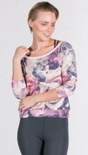 close up front view of model wearing romantic floral roses printed pullover
