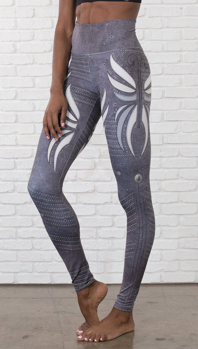 close up front view of model wearing vintage flower printed full length leggings