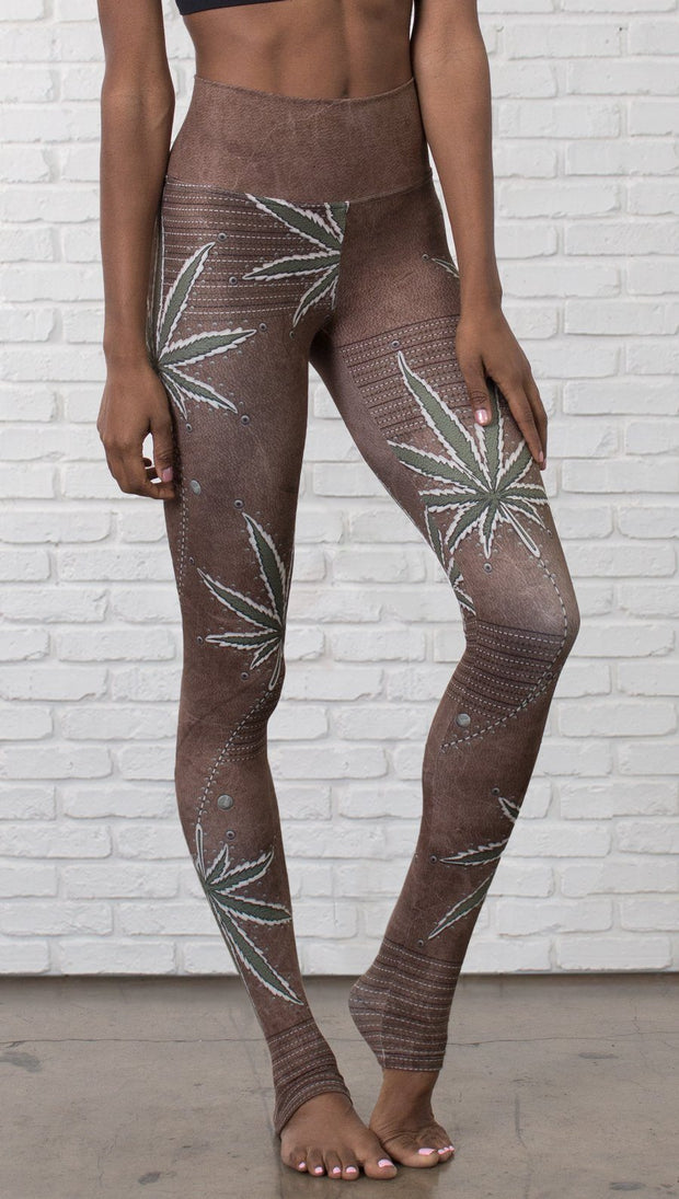 close up front view of model wearing cannabis leaf printed full length leggings