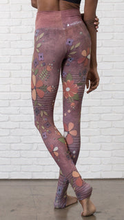 close up back view of model wearing vintage flower pattern printed full length leggings