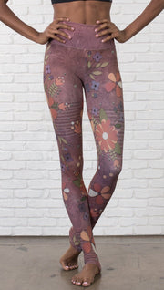 close up front view of model wearing vintage flower pattern printed full length leggings