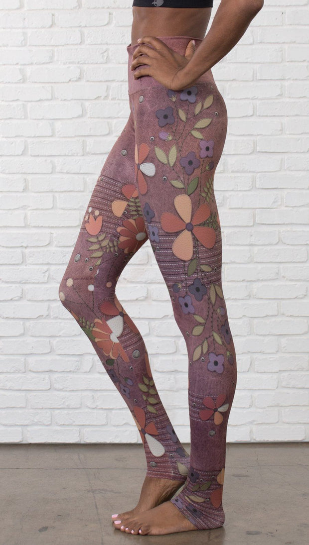 close up left side view of model wearing vintage flower pattern printed full length leggings