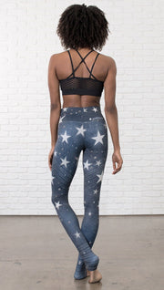 back view of model wearing vintage patriotic stars design full length leggings