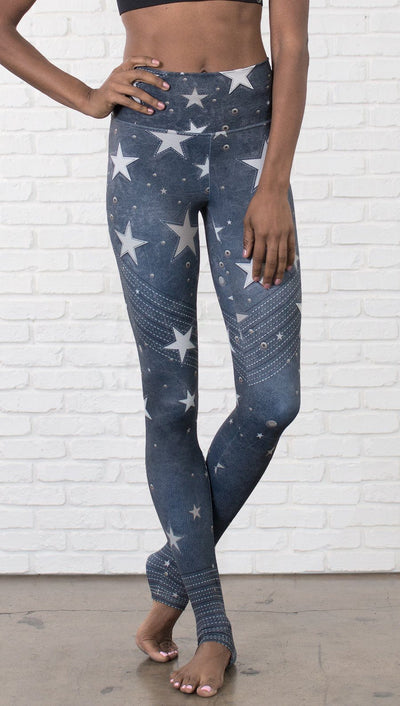 closeup front view of model wearing vintage patriotic stars design full length leggings