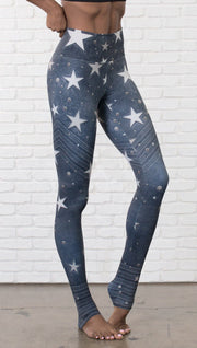 closeup right side view of model wearing vintage patriotic stars design full length leggings