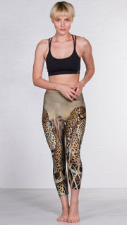front view of model wearing capri leggings with printed leopard design
