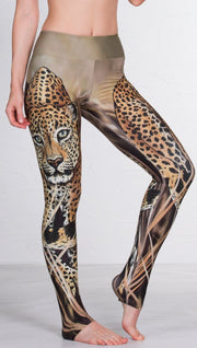 closeup front view of model wearing full length leggings with printed leopard design