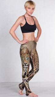 front view of model wearing full length leggings with printed leopard design