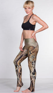 left side view of model wearing full length leggings with printed leopard design