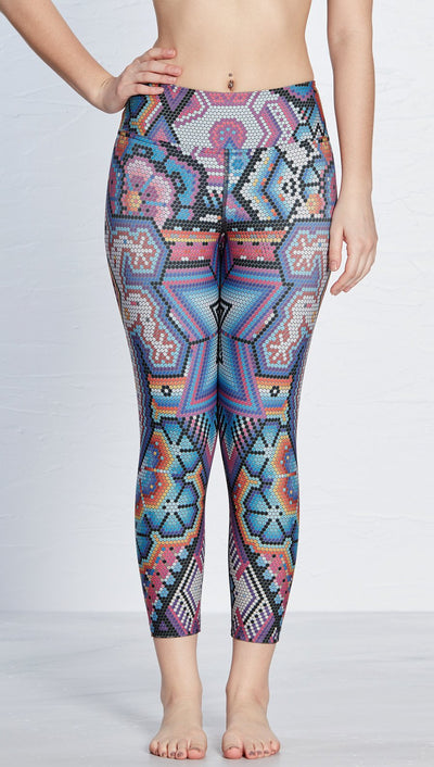 close up front view of latin beads themed printed capri leggings with lizard design