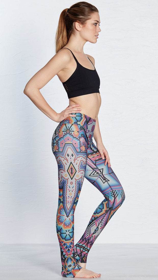 right side view of model wearing purple beaded lizard themed printed full length leggings